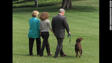 President Bill Clinton, First Lady Hillary Clinton, and their daughter Chelsea depart the White House with their dog Buddy on their way to a two-week vacation in Martha's Vineyard, Massachusetts. Clinton gave a televised address the evening before to the American people from the White House in which he admitted to an improper relationship with former White House intern Monica Lewinsky.