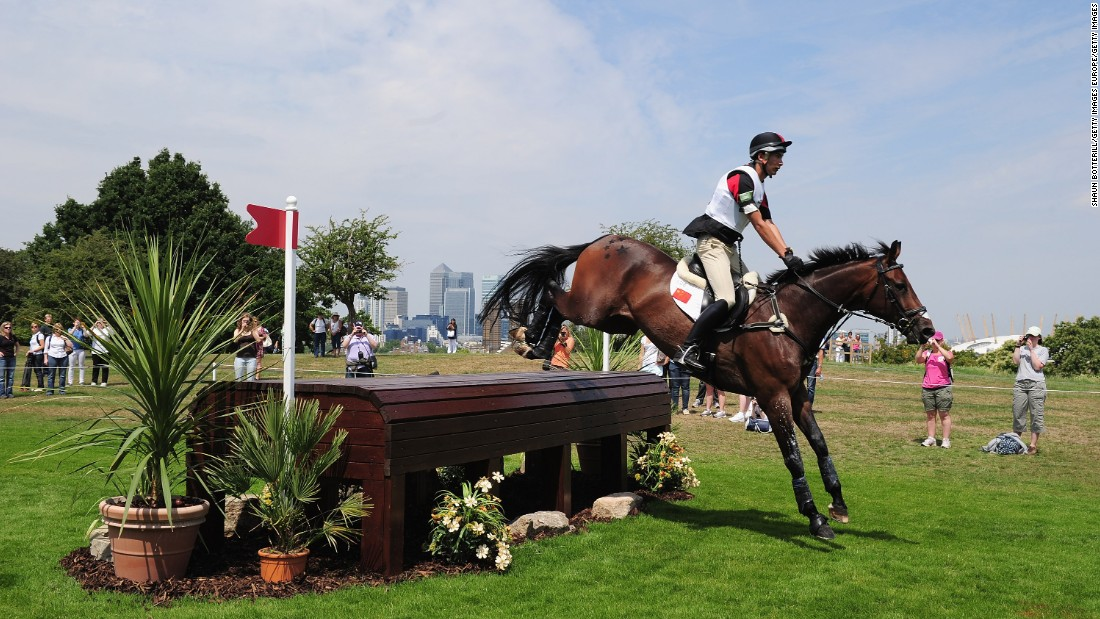 Hua Tian, riding Furst Love, jumps the 12th fence during a London Olympics test event in Greenwich Park in 2012.