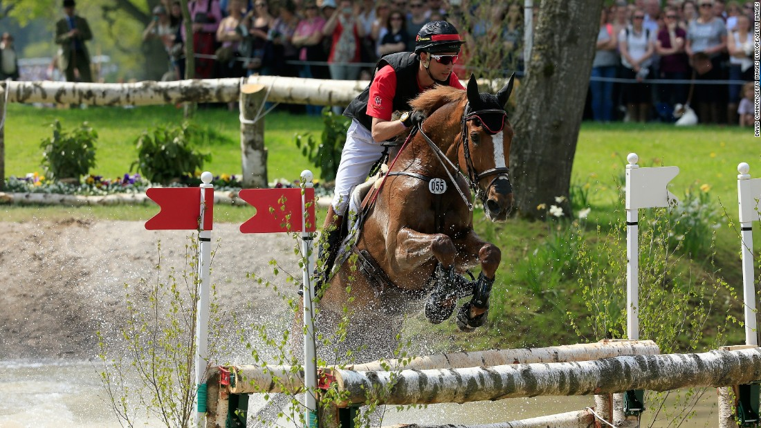 """Hua Tian's enthusiasm came from his mother, who had what he describes as """"a very British equestrian upbringing, despite living and working in China."""" Here, he is pictured riding Harbor Pilot C  at the Badminton Horse Trials in 2016."""
