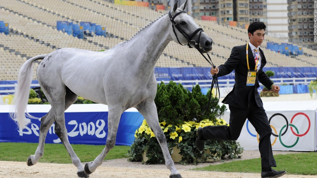Hua Tian, who was China's youngest-ever eventing rider, shows his horse Watership Down on the first inspection for the eventing competition for the Beijing Games. The competition took place in Hong Kong to get around mainland China's quarantine rules.