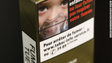 "A picture taken on September 25, 2014 shows a sample of a ""plain cigarette packaging"" cigarette box proposed by the ""Alliance contre le tabac"" (alliance against tobacco) association. France on September 25 said it would introduce plain cigarette packaging and ban electronic cigarettes in certain public places, in a bid to reduce high smoking rates among the under-16s. Following a successful similar campaign in Australia, Health Minister Marisol Touraine said cigarette packets would be ""the same shape, same size, same colour, same typeset"" to make smoking less attractive to young smokers.    AFP PHOTO THOMAS SAMSON        (Photo credit should read THOMAS SAMSON/AFP/Getty Images)"