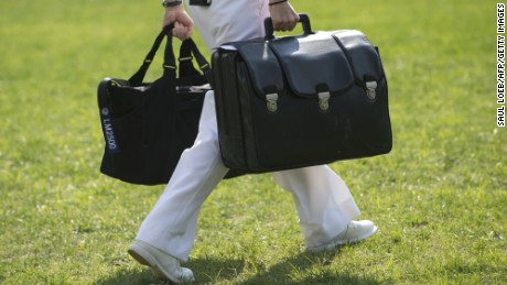 A White House military aide carries a briefcase containing emergency codes.
