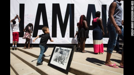 """An """"I Am Ali"""" poster covered an entire wall at the Kentucky Center in Louisville on Wednesday, June 8. A downtown festival celebrated the life of the legendary boxer Muhammad Ali, who died Friday at 74. (Philip Scott Andrews for CNN)"""
