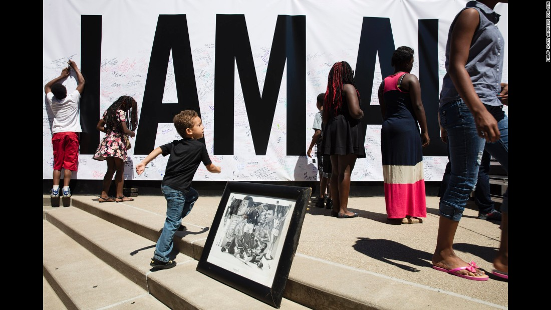 "A poster that says ""I Am Ali"" covers a wall at the Kentucky Center for the Arts in Louisville, Kentucky. A <a href=""http://www.cnn.com/2016/06/08/us/muhammad-ali-celebration/"" target=""_blank"">festival</a> was held there Wednesday, June 8, for <a href=""http://www.cnn.com/2016/06/03/sport/gallery/muhammad-ali/index.html"" target=""_blank"">boxing legend Muhammad Ali,</a> a Louisville native who died June 3 at the age of 74. <a href=""http://www.cnn.com/2016/06/09/sport/gallery/tbt-muhammad-ali/index.html"" target=""_blank"">#tbt: Behind the scenes with Muhammad Ali</a>"