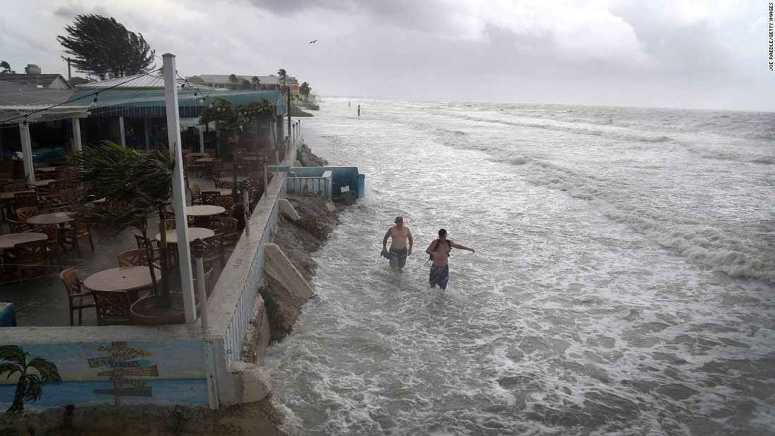 "People walk on the beach in Fort Myers, Florida, as waves from Tropical Storm Colin crash along the shore on Monday, June 6.  The storm <a href=""http://www.cnn.com/2016/06/07/us/tropical-storm-colin/"" target=""_blank"">brought heavy rains and wind gusts</a> to the Southeast."