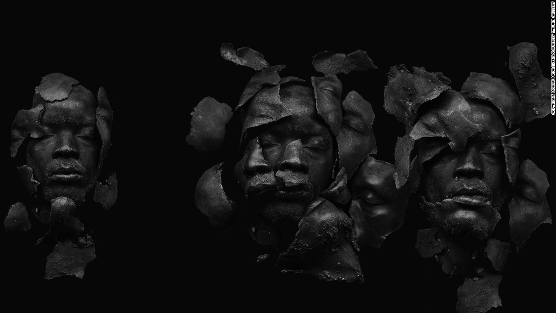 "Fossils Black is a work that deceives the eye. Although it looks like a photograph, it is actually a scan. The artist made a cast of his face which was then broken into several pieces and arranged onto a scanner bed. ""I grew up in a part of Soweto that witnessed a lot of conflict"" he says. The 1990s saw bloody clashes between followers of the  African National Congress (ANC) and Inkatha Freedom Party (IFP)."