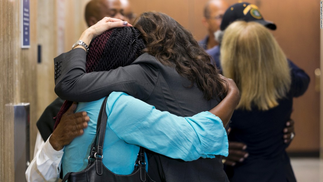 "People hug in Los Angeles Superior Court on Monday, June 6, after <a href=""http://www.cnn.com/2016/06/06/us/grim-sleeper-sentence/"" target=""_blank"">a jury recommended death</a> for the serial killer known as the ""Grim Sleeper."" Lonnie David Franklin Jr., a former city sanitation worker, was convicted in May of 10 counts of first-degree murder and one count of attempted murder. A judge will decide his sentence in August."