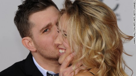 Singer Michael Buble and model Luisana Loreley Lopilato de la Torre arrive on the red carpet for the 2010 American Music Awards at the Nokia Theatre in Los Angeles on November 21, 2010.       AFP PHOTO/Mark RALSTON (Photo credit should read MARK RALSTON/AFP/Getty Images)