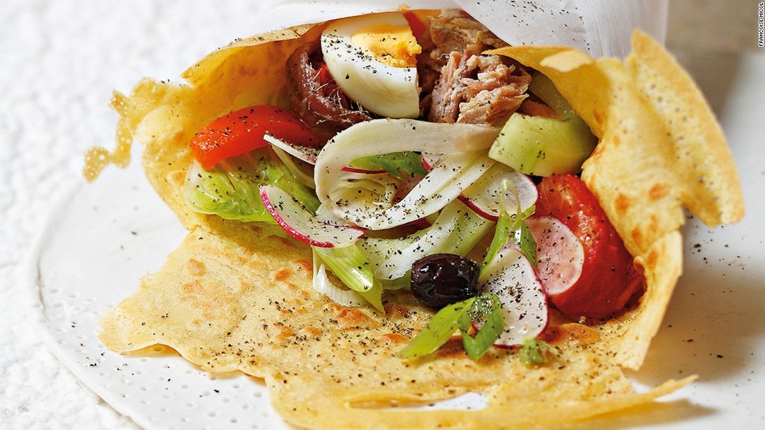 "For Alain Ducasse or Monaco's Le Louis XV, Rivea London chef Damien Leroux's Nicoise salad is a memorable experience. ""Damien gently wraps the ingredients of the Nicoise salad into the warm crispy socca [the thin, unleavened pancake from Genoa],"" recalls Ducasse."