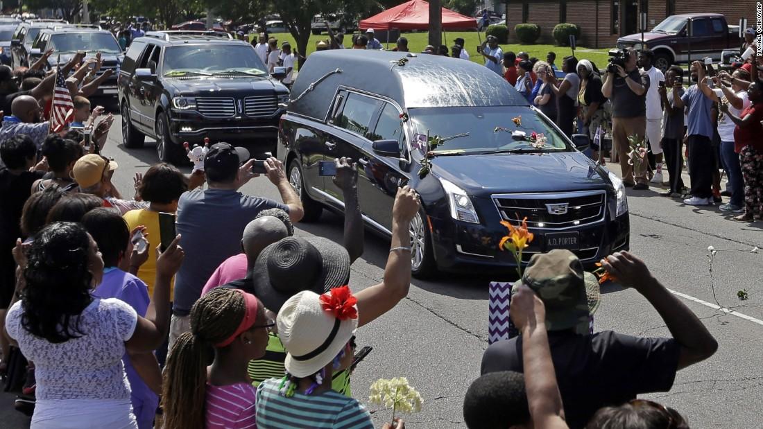 The procession makes its way down Muhammad Ali Boulevard.