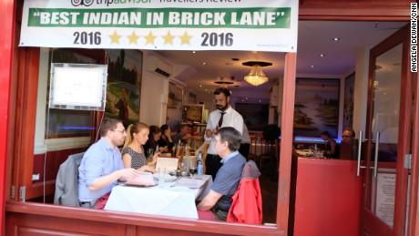 Diners choose from a long list of curries on London's Brick Lane.