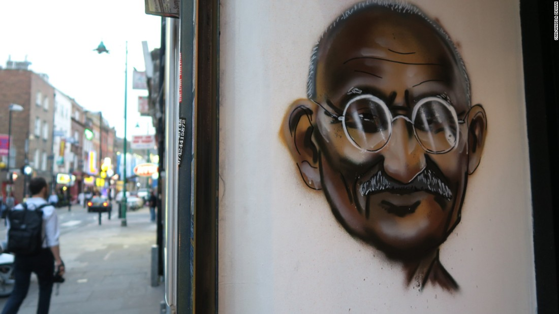 Indian hero Mahatma Gandhi is painted on the wall of a restaurant on Brick Lane.