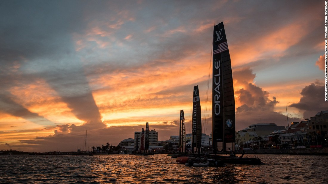 The sun sets over Hamilton, the capital of Bermuda, after a training day last year during the America's Cup World Series. Next year's finals may give its economy a $250 million boost, local organizers say.