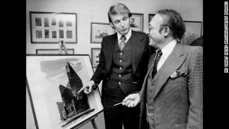 Donald Trump with Alfred Eisenpreis, the New York City Economic Development Administrator, look over a sketch of new 1,400 room Renovation project of Commodore Hotel in 1976.