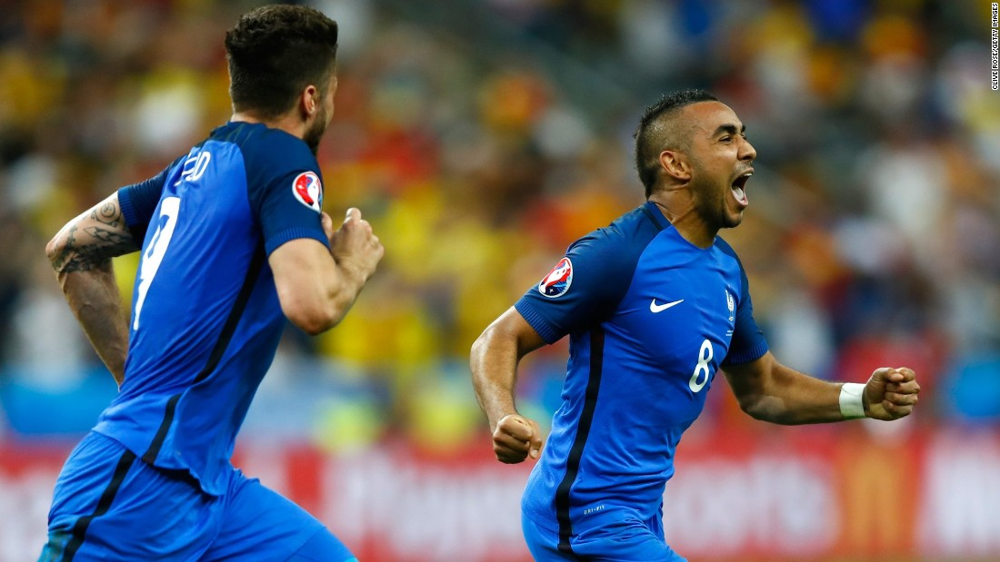 Dimitri Payet, right, celebrates his spectacular goal that gave France a 2-1 victory over Romania in the opening match of Euro 2016. The match was played in the Stade de France just north of Paris.