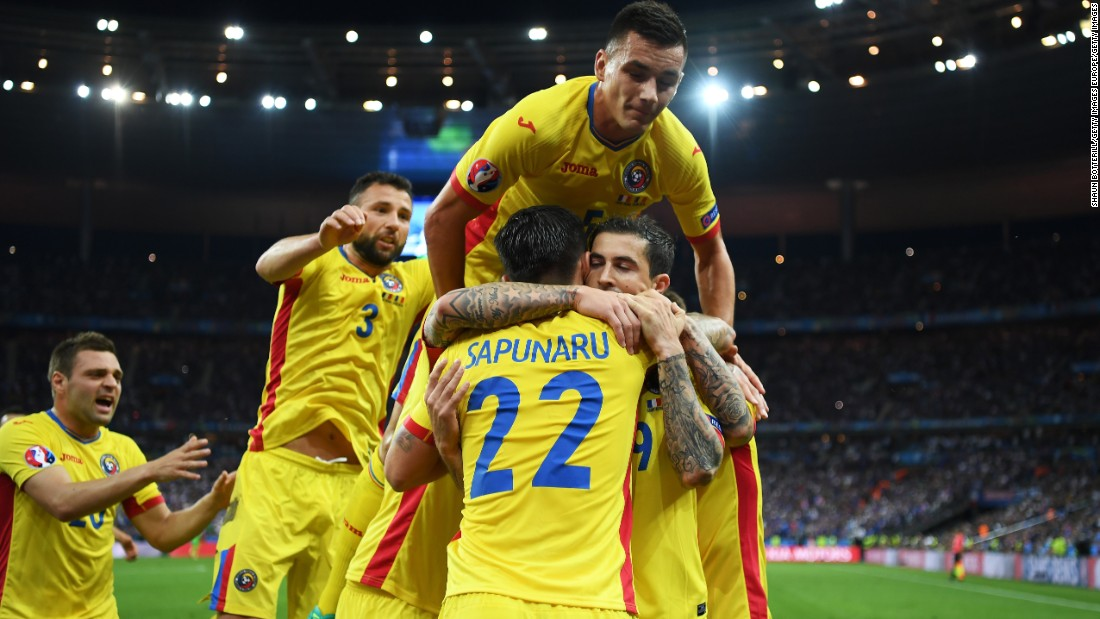 Romanian players celebrates Stancu's goal.