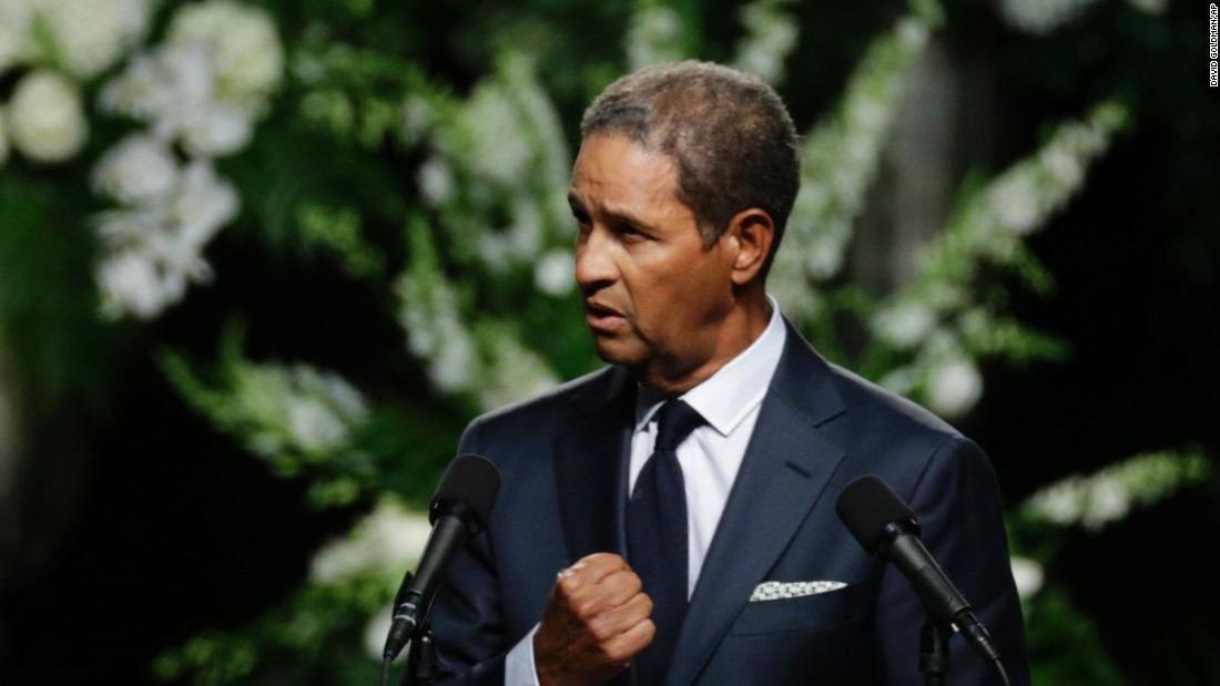 """Sportscaster Bryant Gumbel said he was honored to speak at Ali's service, saying """"to be standing here by his and Lonnie's request is mind-numbing. God bless you, Champ."""""""