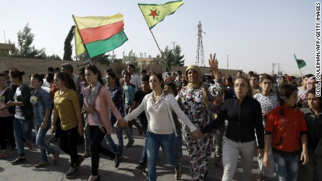 Syrian Kurds march during the funeral of fighters, who died during an assault launched by Arab and Kurdish forces against Islamic State (IS) group fighters in the town of Manbij.