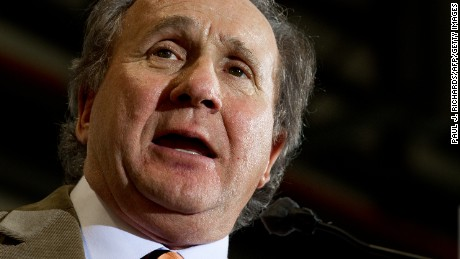 Michael Reagan, a radio show talk host and son offormer US president Ronald Reagan, delivers opening remarks shortly before the arrival of Republican presidential hopeful, former House Speaker Newt Gingrich, inside an aircraft hangar at the Tampa Jet Center, January 30, 2012, in Tampa, Florida.