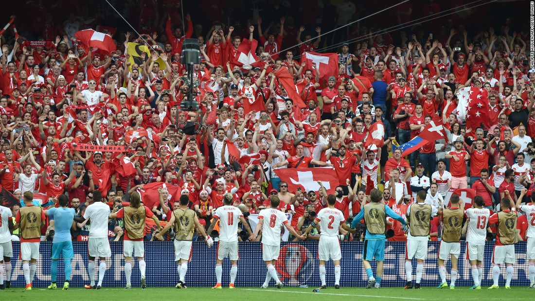 Switzerland's players celebrate their 1-0 victory over Albania with their supporters at the Bollaert-Delelis Stadium in Lens, France, on Saturday, June 11.
