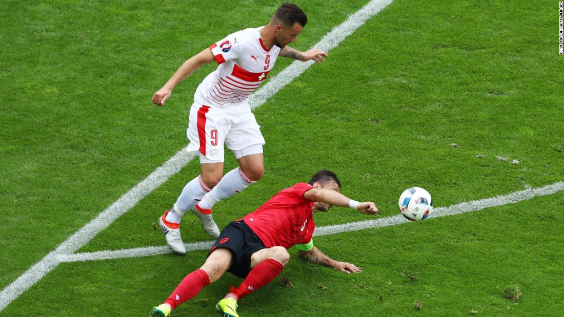 Lorik Cana of Albania touches the ball with his hand resulting in the second yellow card .Cana was later ejected from the game.