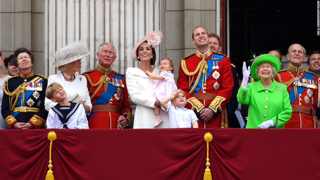 Members of the royal family gather on a balcony in June 2016, during celebrations marking the 90th birthday of Queen Elizabeth II. From left are Princess Anne; Camilla, the Duchess of Cornwall; Prince Charles; Catherine, the Duchess of Cambridge; Princess Charlotte; Prince George; Prince William; Prince Harry; Queen Elizabeth II; and Prince Philip.