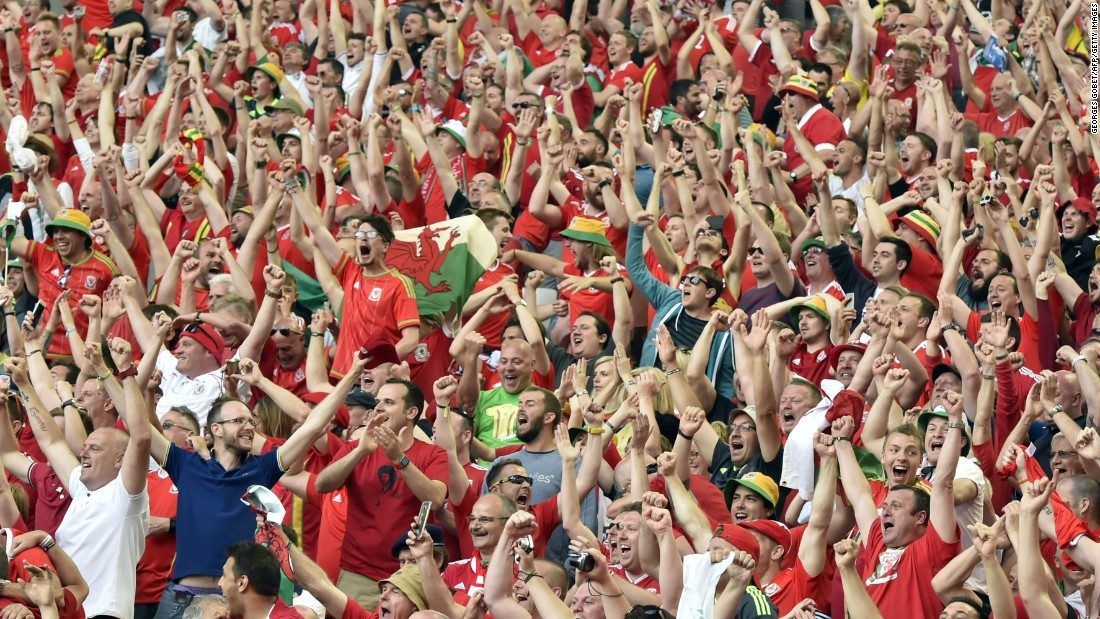 Wales fans celebrate their team's 2-1 win over Slovakia in the Euro 2016 at the Stade de Bordeaux in Bordeaux, France on Saturday,June 11.
