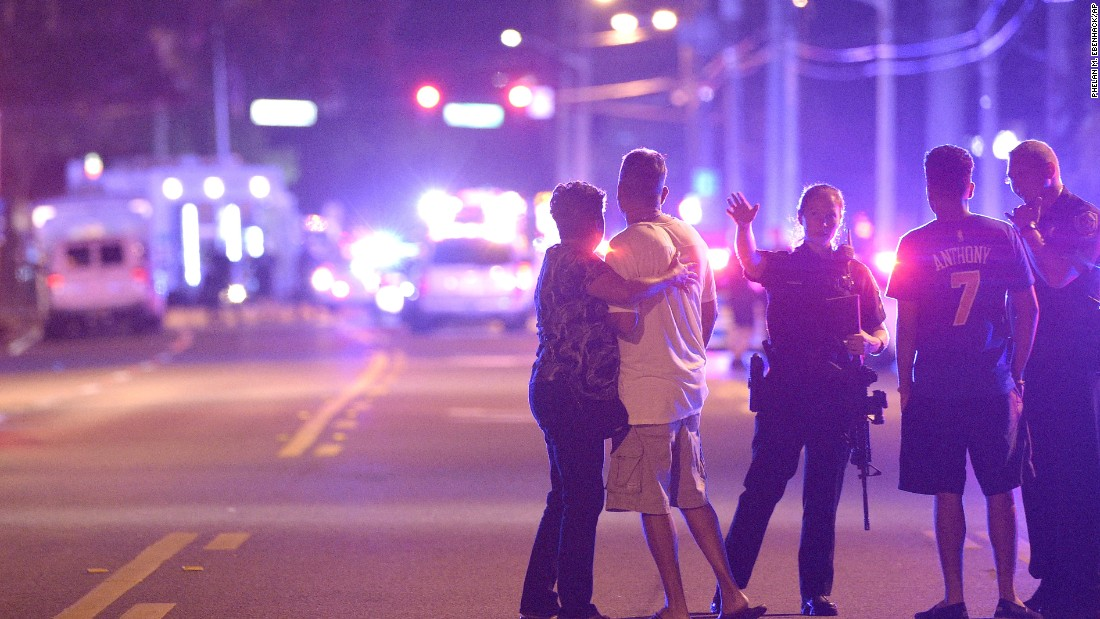 "Police direct family members away from the scene of a shooting Sunday, June 12, at the Pulse nightclub in Orlando. <a href=""http://www.cnn.com/2016/06/12/us/orlando-nightclub-shooting/index.html"">A gunman opened fire at the club,</a> killing 50 people and injuring at least 53, police said. It is now the deadliest shooting rampage in U.S. history."