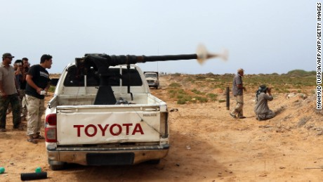 Forces loyal to Libya's UN-backed unity government fire during clashes with jihadists of the Islamic State (IS) group at the western entrance of Sirte on June 2, 2016. According to Libyan officials fighting resumed on June 1 on the outskirts of Sirte between their forces and jihadist during which three pro-government troops had been killed and 10 more wounded. Sirte was the hometown of slain dictator Moamer Kadhafi and, since seizing it in June last year, IS has turned it into a recruitment and training camp / AFP / MAHMUD TURKIA        (Photo credit should read MAHMUD TURKIA/AFP/Getty Images)