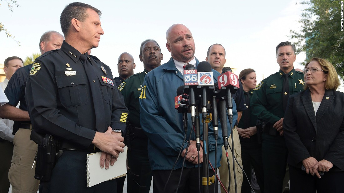 Ron Hopper of the FBI answers questions from members of the media on June 12. Listening are Orlando Police Chief John Mina, left, and Orange County Mayor Teresa Jacobs.