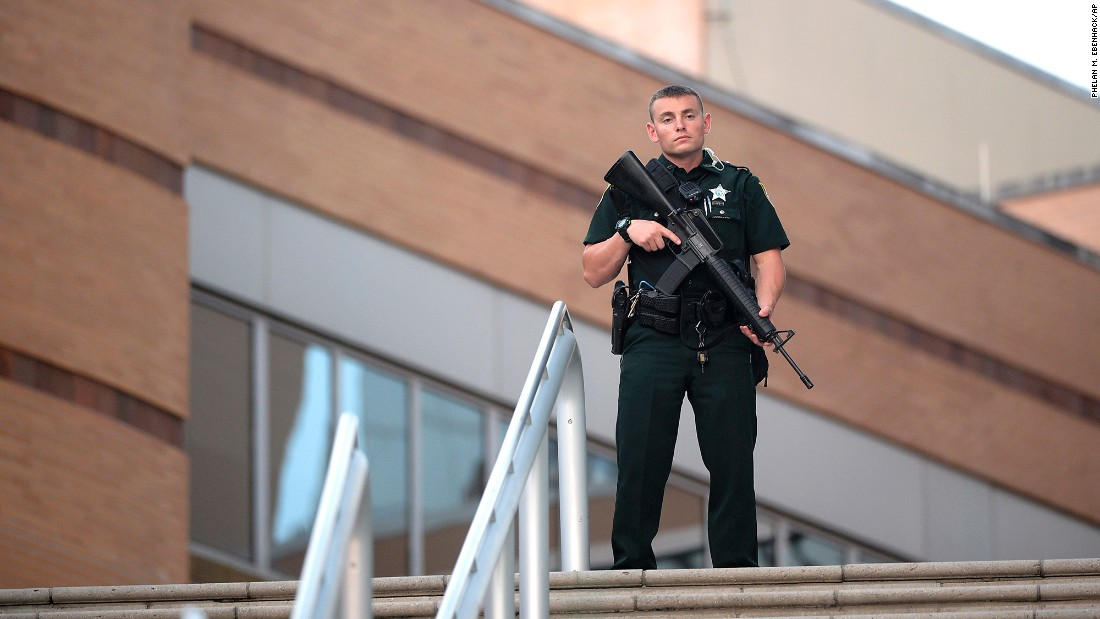 A police officer stands guard outside the Orlando Regional Medical Center.