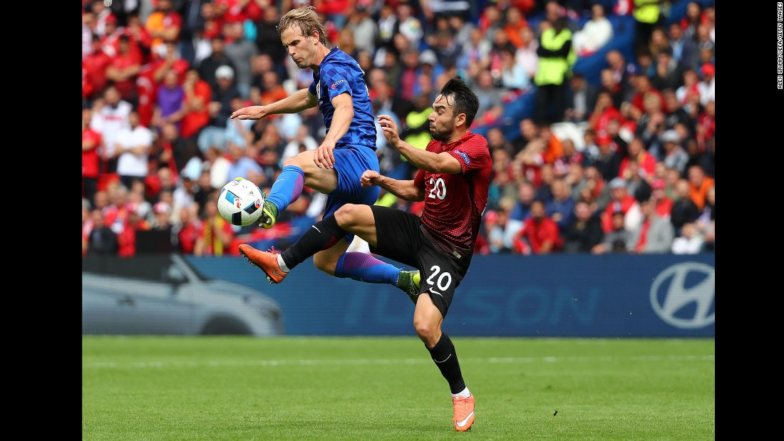 Turkey's Volkan Sen, right, competes against Croatia's Ivan Strinic.