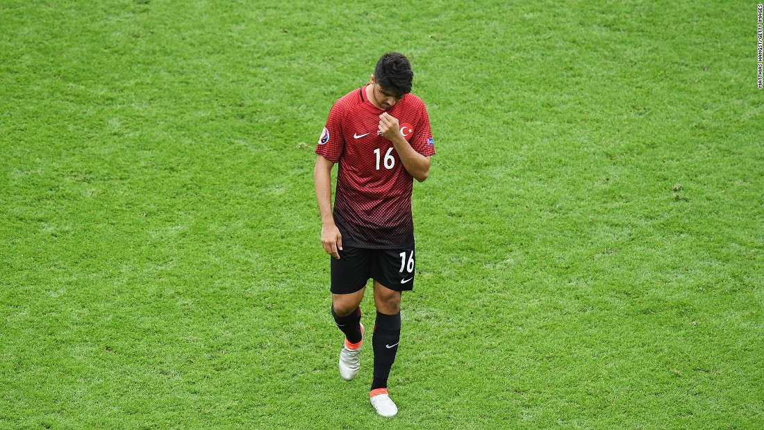 Turkey's Ozan Tufan leaves the pitch after enduring a frustrating afternoon.