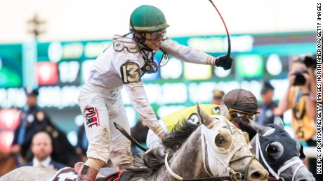 Irad Ortiz Jr. celebrates riding Creator to victory in the Belmont Stakes in a photo finish with Destin.