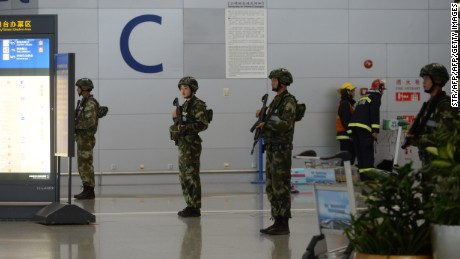 Armed troops inside Pudong airport seal off part of the arrivals terminal.