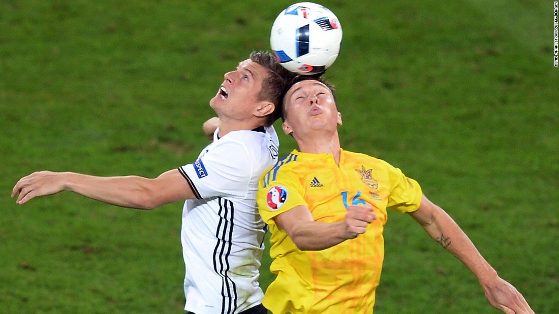 Germany's Toni Kroos, left, competes for the ball with Ukraine's Serhiy Sydorchuk.