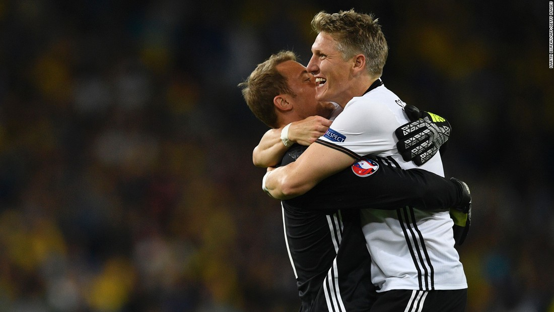 Schweinsteiger celebrates Germany's second goal with goalkeeper Manuel Neuer.