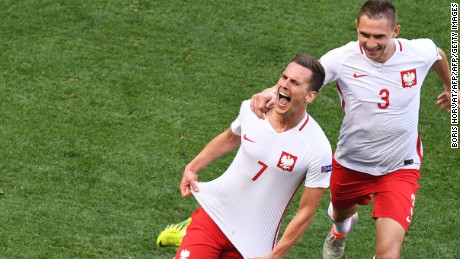 Arkadiusz Milik celebrated after firing Poland ahead in the second half.