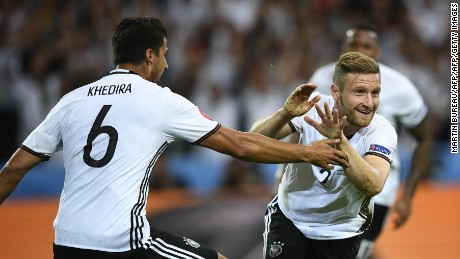 Germany's defender Shkodran Mustafi (R) celebrates with Germany's midfielder Sami Khedira after scoring a goal during the Euro 2016 group C football match between Germany and Ukraine at the Stade Pierre Mauroy in Villeneuve-d'Ascq near Lille on June 12, 2016. / AFP / MARTIN BUREAU        (Photo credit should read MARTIN BUREAU/AFP/Getty Images)