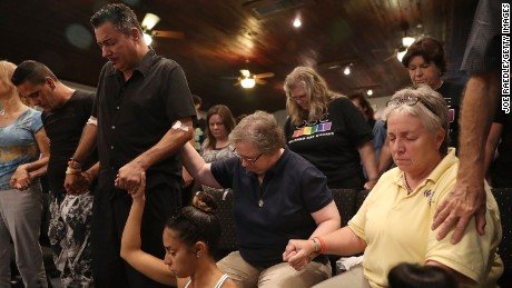 ORLANDO, FL - JUNE 12: Orlando (did not want to provide his last name) (2nd L) who was injured in the mass shooting at the Pulse Nightclub attends a memorial service at the Joy MCC Church for the victims of the terror attack where Omar Mateen allegedly killed more than 50 people on June 12, 2016 in Orlando, Florida. The mass shooting killed at least 50 people and injuring 53 others in what is the deadliest mass shooting in the countryÕs history. (Photo by Joe Raedle/Getty Images)