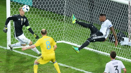 Germany's defender Jerome Boateng clears the ball from his goal.