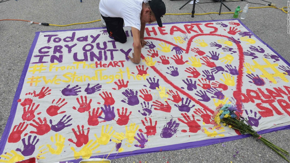 A man places a handprint on a makeshift memorial near the nightclub where the attack took place.
