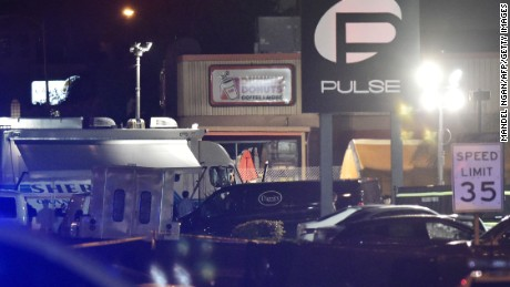CORRECTION - A van from a funeral service is seen infront of the Pulse club in Orlando, Florida,on June 12, 2016. 