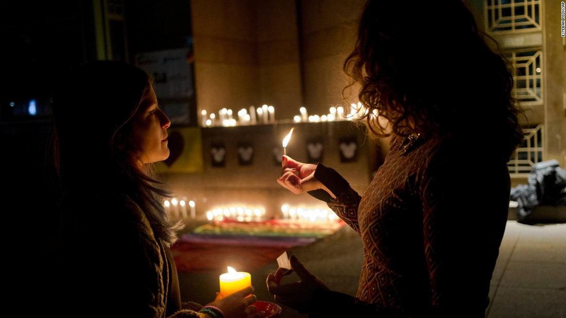 Two women light candles during a vigil in front of the U.S. Embassy in Santiago, Chile, on June 12.