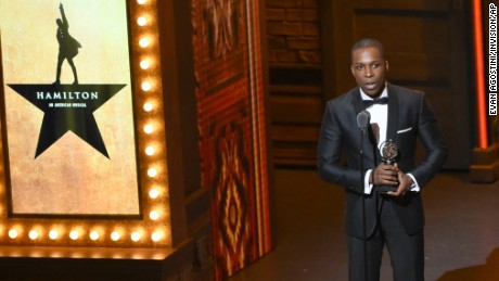 "Leslie Odom Jr. accepts the award for leading actor in a musical for ""Hamilton"" at the Tony Awards Sunday in New York."