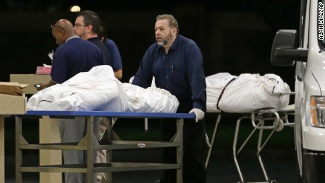 Two bodies of victims arrive at the Orlando Medical Examiner's Office, Sunday, June 12, 2016, in Orlando, Fla. A gunman opened fire inside a crowded gay nightclub early Sunday, before dying in a gunfight with SWAT officers, police said. (AP Photo/Alan Diaz)