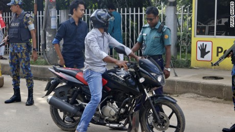 A man on a motorcycle is stopped at a police check-post in Gulshan in the capital of Dhaka.