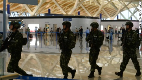 "Paramilitary police officers patrol inside Pudong airport in Shanghai after an explosion near a check-in counter on June 12, 2016.  A blast caused by ""home-made"" explosives injured four people and sparked a major security alert at the main international airport in China's commercial hub of Shanghai on June 12, according to the operator and state media. / AFP / STR / China OUT        (Photo credit should read STR/AFP/Getty Images)"