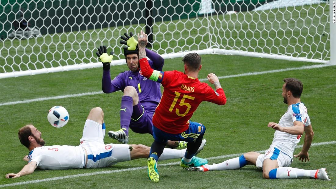 Spain's Sergio Ramos is denied during a goalmouth scramble.