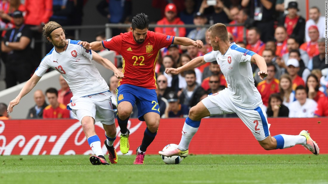 Spain's Nolito is defended by Jaroslav Plasil, left, and Pavel Kaderabek.